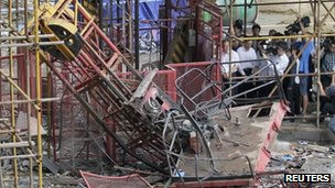 Hubei province government officials inspecting a collapsed lift 13 September 2012