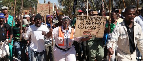 Striking miners march on 11 September 2012 in Carletonville, west of Johannesburg.