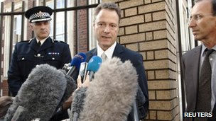 Eric Maillaud (centre) speaks to reporters outside Woking police station
