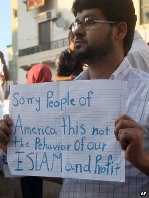 Libyan man holds a placard