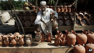 Man sells pottery in Laghman province
