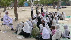 Schoolgirls study in an open air school in the outskirts of Jalalabad