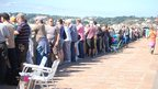 Crowds watching the display along St Aubin's bay