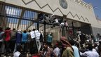 Protesters climbing gates of US embassy in Sanaa