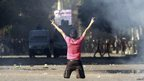 Protester with arms in victory salute