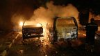 Cars burn in Cairo, Egypt