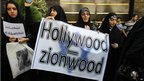 Women holding sign saying 'Hollywood zionwood'