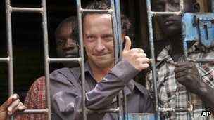 David Cecil stands in a court cell in Kampala, Uganda, 13 September 2012.