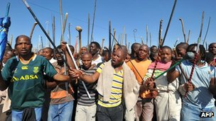 Striking miners walk to the Marikana mine. Photo: September 2012