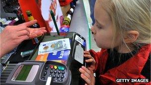 Girl at supermarket checkout