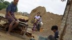 Villagers work at a dump near the Sabal Hill copper mine project in Monywa in northern Sagaing division, Burma