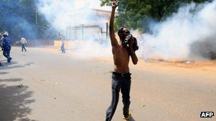 A protester gesticulates outside the German embassy in Khartoum as violence flares in the Sudanese city.