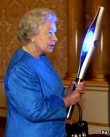 The Queen with the 2002 Manchester Games Baton
