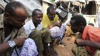 Internally displaced Somalis in Hodan district, Mogadishu, listening to the radio - Monday 10 September 2012