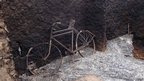 A bicycle in a house burnt in clashes between the Orma and Pokomo communities in Kenya - Tuesday 11 September 2012