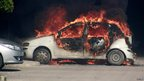 A car burns outside the US embassy in Tunis, Tunisia, 14 September 2012