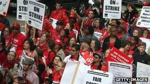 Striking Chicago public school teachers and their supporters march down Michigan Avenue on 13 September 2012 in Chicago, Illinois