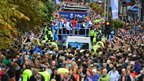 Scottish Olympians wave to members of the public in Buchanan Street during the Olympic Parade