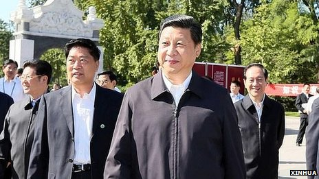 Xi Jinping, centre, was pictured at the China Agricultural University in Beijing