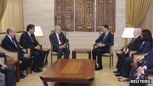 Syria's President Bashar al-Assad (centre right) meets UN-Arab League peace envoy for Syria Lakhdar Brahimi (centre left) in Damascus on Saturday in this handout photograph released by Syrian national news agency Sana