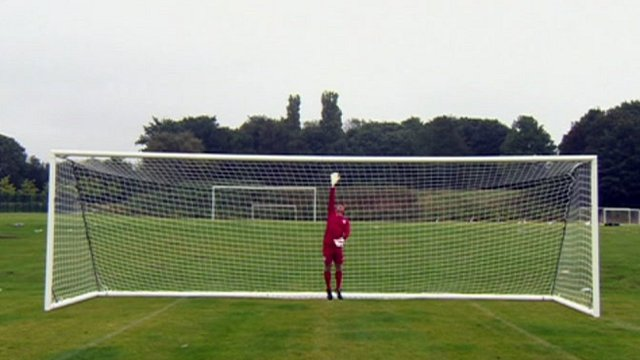Mike Bushell in a scaled-up football goal