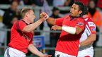 Keith Earls is congratulated by Casey Laulala after scoring Musnter&#039;s only try of the game