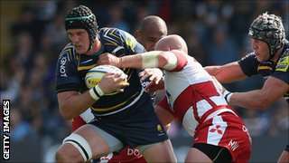 Worcester Warriors' James Percival evades Nick Wood of Gloucester