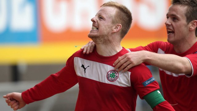 Cliftonville's George McMullan celebrates scoring the winner with team-mate Jaimie McGovern