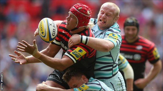 Mouritz Botha of Saracens is tackled by Leicester&#039;s Dan Cole and Sam Harrison