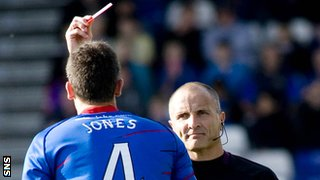Owain Tudur Jones is shown a red card by George Salmond