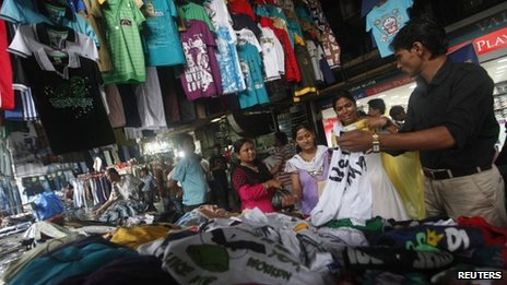 People shop for clothes at a roadside market in Calcutta. Photo: 15 September 2012