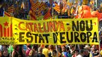 "Pro-independence marchers hold up a banner reading ""Catalonia, a new European state"" in Barcelona 11 September 2012"