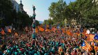 Crowds surround an acrobatic display in celebration of Catalonia's independence rally, 11 September 2012