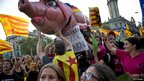 Catalan march alongside a large model of a pig in Barcelona, 11 September 2012