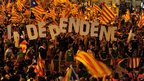 "Marchers spell-out the word ""independence"" in giant letters at the Catalonia independence rally in Barcelona 11 September 2012"