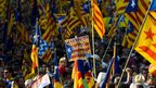 Pro-independence marchers wave Catalan independence flags in Barcelona, Spain on 11 September 2012