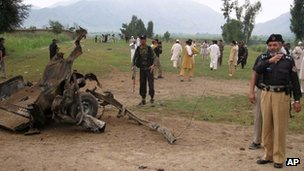 Police near the wreckage of the vehicle
