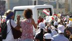 Women taken photos of the Pope in his popemobile