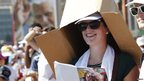 Woman with cardboard box on her head
