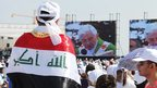 Man wrapped in Iraqi flag watching Pope in Beirut