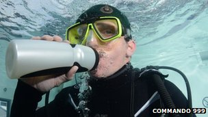 Chris Sirett drinking water during the underwater challenge