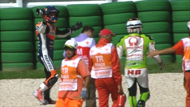 Dani Pedrosa walks away from his collision with Hector Barbera.