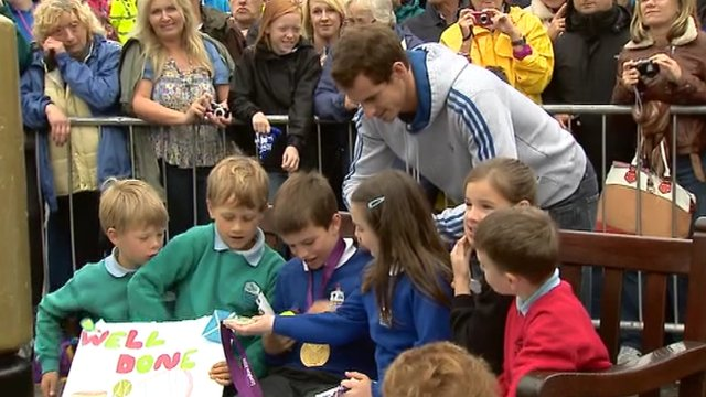 British tennis number one Andy Murray meets some school pupils from Dunblane