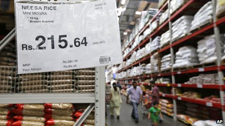 A sign gives details of savings for a particular product at a Bharti-Walmart store on the outskirts of Chandigarh, India, Sunday, Sept. 16, 2012.