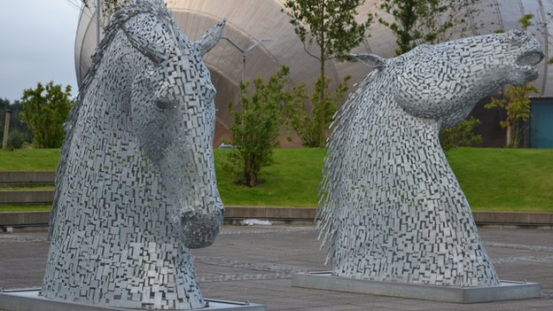 A small-scale replica of The Kelpies has been on display outside the BBC in Glasgow