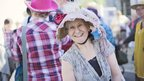 Woman in hat at Bridport Hat Festival