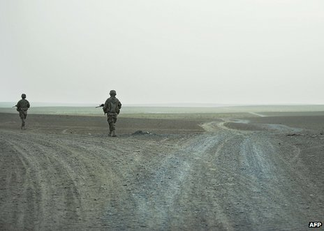 Two US soldiers patrol in Kandahar Province, 13 September