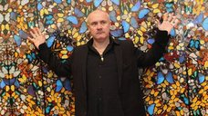 Damien Hirst in front of his Doorways to the Kingdom of Heaven artwork