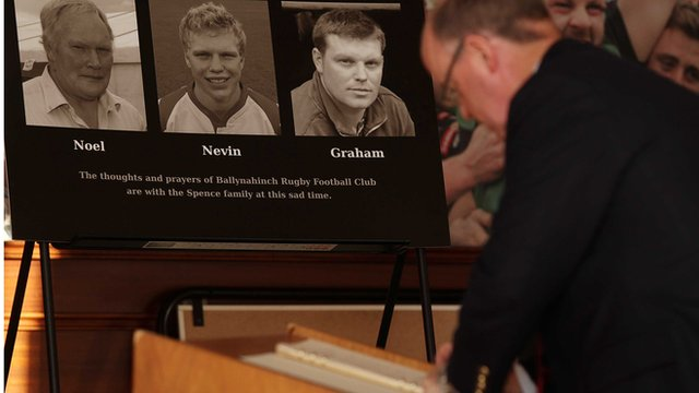 A book of condolence is signed at Ballynahinch Rugby Club