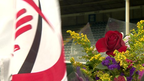 Ulster rugby flag and flowers